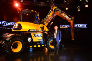 JCB Chairman Lord Bamford pictured with the newly launched JCB Hydradig.